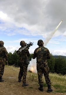 A three-person JASDF fireteam fires a missile from a Type 91 Kai MANPAD during an exercise at Eielson Air Force Base, Alaska as part of Red Flag - Alaska.