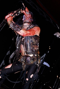 Watain singer Erik Danielsson in torn clothes and covered with blood