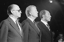 Celebrating the signing of the 1978 Camp David Accords: Menachem Begin, Jimmy Carter, Anwar Sadat
