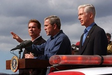 Governor-elect Arnold Schwarzenegger, President George W. Bush and Governor Gray Davis speak to firefighters on November 4, 2003.