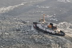 The U.S. Coast Guard Cutter Thunder Bay (WTGB-108) clears a channel for vessels to navigate the frozen Hudson River