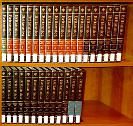 15th edition of the Britannica. The initial volume with the green spine is the Propædia; the red-spined and black-spined volumes are the Micropædia and the Macropædia, respectively. The last three volumes are the 2002 Book of the Year (black spine) and the two-volume index (cyan spine).