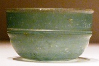 A green Roman glass cup unearthed from an Eastern Han Dynasty (25–220 AD) tomb in Guangxi, southern China; the earliest Roman glassware found in China was discovered in a Western Han tomb in Guangzhou, dated to the early 1st century BC, and ostensibly came via the maritime route through the South China Sea[290]