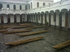 Antique dug out canoes in the courtyard of the Old Military Hospital in the Historic Center of Quito