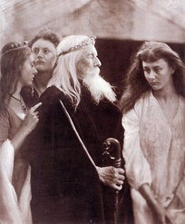 Three of Liddell's children (l to r) Lorina, Edith and Alice, photographed by Julia Margaret Cameron in 1872. The central figure is Charles Hay Cameron as King Lear.