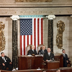 Hayden seated to the left of John W. McCormick during a 1963 speech by President Lyndon B. Johnson to a joint session of Congress