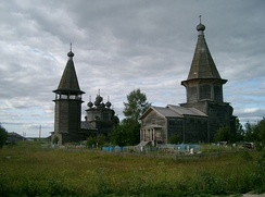The triple church ensemble in the selo of Lyadiny, Kargopolsky District. In 2013, the bell tower and the Intercession Church (right) burned to the ground.