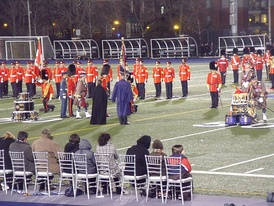Prince Charles, Prince of Wales, presents new colours to the Royal Regiment of Canada and Toronto Scottish Regiment at Varsity Stadium in Toronto, 5 November 2009