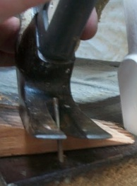The claw of a carpenter's hammer is frequently used to remove nails.