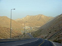 Muscat's rugged terrain, with plutonic Central Hajar Mountains dotting the landscape