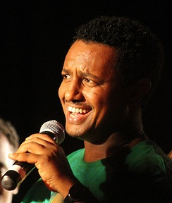 Teddy Afro singing at a concert