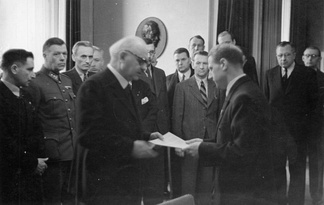 Conti being presented with a report on the Katyn massacre discovered by the Germans in 1943