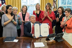Ernst attending the signing, by President Donald Trump, of the INSPIRE Women Act on Tuesday, February 28, 2017, in the Oval Office of the White House.