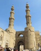 Bab Zuweila, a Fatimid gate with the Mamluk minarets of the Mosque of Sultan al-Mu'ayyad on top.