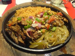 Fajitas, which are typically served with soft flour tortillas