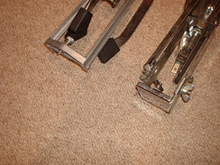 Two hi-hat stands, both with retractable spikes extended