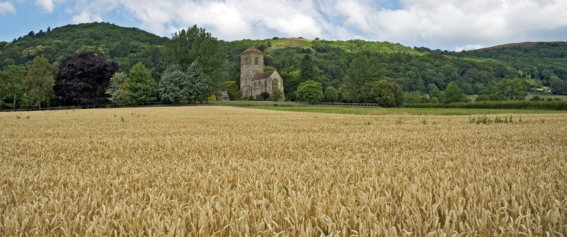 Panorama of the Malvern Hills (AONB) with Little Malvern Priory taking centre stage.