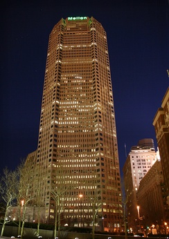 Corporate headquarters, One Mellon Center in Pittsburgh, at night.