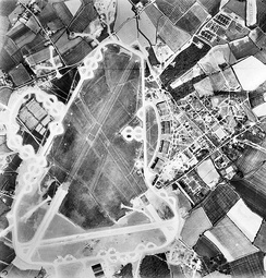 27 May 1944 Aerial photograph of RAF Wattisham the control tower and airfield code are in front of the four C-Type hangars on the right.