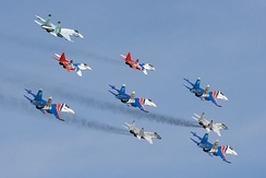 Russian Knights and Swifts aerobatic teams, performing on Su-27s and MiG-29s (Watch on YouTube).