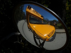 Vision field of a school bus crossview mirror, which allows bus driver to observe blind spots close to vehicle.