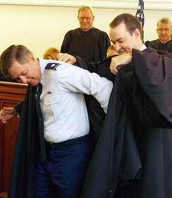 Graham being robed as a judge for the Air Force Court of Criminal Appeals, November 2003.