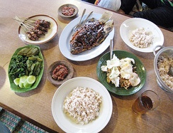 Indonesian typical communal meal, consist of nasi (steamed rice), lauk-pauk (side dishes), and sayur-mayur (vegetables).