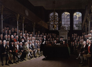 William Pitt the Younger addressing the House of Commons. Pitt's 19 years as Prime Minister followed by Lord Liverpool's 15, led the Tory Party to accept the office as a convention of the constitution.