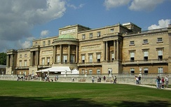 The west façade of Buckingham Palace, faced in Bath stone, seen from the palace garden