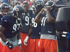 Harris, along with Adewale Ogunleye, Alex Brown and Mark Anderson during training camp in 2008