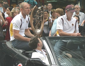 Darren Lockyer and Wayne Bennett parade the premiership after the Brisbane Broncos' Grand Final victory in 2006.