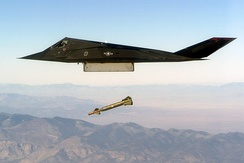 An F-117 conducts a live exercise bombing run using GBU-27 laser-guided bombs.