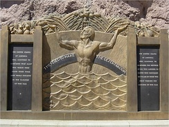 "Oskar J. W. Hansen's memorial at the dam which reads in part ""They died to make the desert bloom.""[71]"