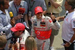 Lewis Hamilton greets press and fans after winning his second race in a row from the pole
