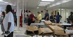 Voters wait in queue at a polling station in New Orleans