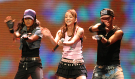 Namie Amuro (center) performs at MTV Asia Aid in Bangkok, Thailand in 2005.