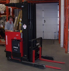 A reach truck with a pantograph allowing the extension of the forks in tight aisles.
