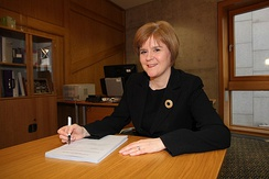 Sturgeon, as Deputy First Minister, signs the Scottish Independence Referendum Act 2013