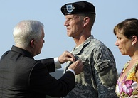 Gates decorates McChrystal with the Defense Distinguished Service Medal at his retirement ceremony on July 23, 2010.