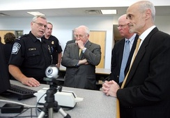 A U.S. Customs and Border Protection Officer addresses Dick Cheney (center), then Vice President of the United States, Saxby Chambliss (center right), a U.S. senator from Georgia and Michael Chertoff (far right), then United States Secretary of Homeland Security in 2005