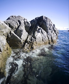Waves and water chemistry lead to structural failure in exposed rocks