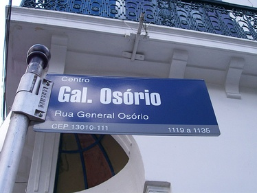 A street sign indicating a Brazilian Postal Code (13010-111) at its bottom, in Campinas.