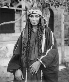 Arab Christian Bedouin woman from the settled town of Kerak, Jordan, who probably was the wife of a sheikh. Braids were predominantly worn by Arab Christian Bedouin women of the tribes of Jordan.[12]
