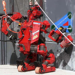 Tartan Rescue's CHIMP cuts wallboard at the 2013 DARPA Robotics Challenge Trials
