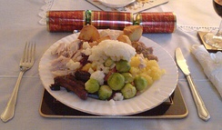 A Christmas dinner plate in Scotland, featuring roast turkey, roast potatoes, mashed potatoes and brussels sprouts