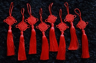 Eight examples of one traditional Chinese knot.
