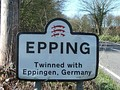 Sign in the United Kingdom showing the twinning of Epping, England with similarly-named Eppingen in Germany.
