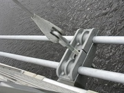 An angled dropper, deck support and bowstring cables