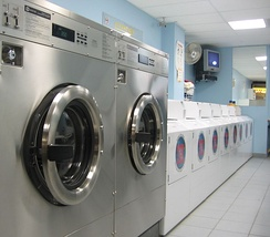 Commercial washing machines in a self-service laundromat (Toronto, Canada)