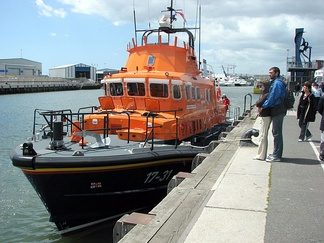 Foredeck of Severn-class lifeboat No. 17-31 at quay in Poole Harbour, Dorset, England.